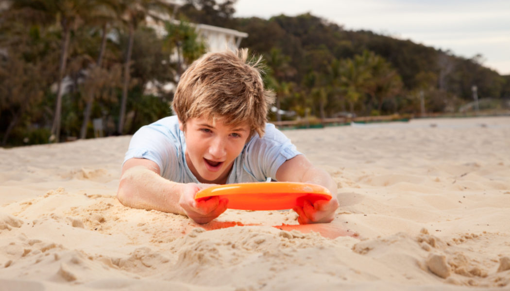 Catching Frisbee in Sand